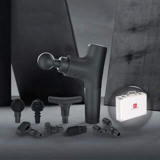 Massagepistol i eksklusivt design, med 7 hoveder og en lækker alu kuffert.